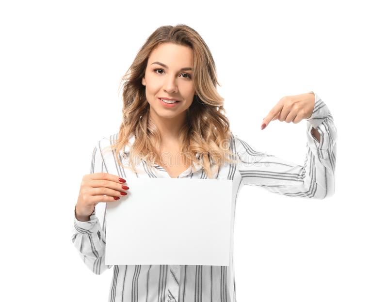 Portrait of beautiful young woman with blank paper sheet on white background stock images