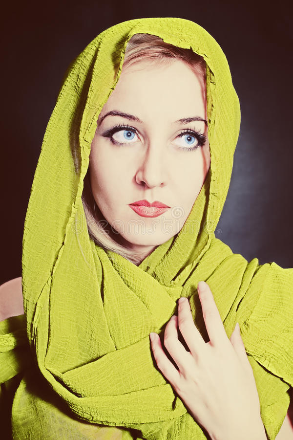 Portrait of beautiful young woman in bright, green head scarf stock photo