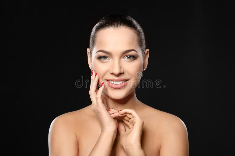Portrait of beautiful young woman with bright manicure. Nail polish trends royalty free stock photo