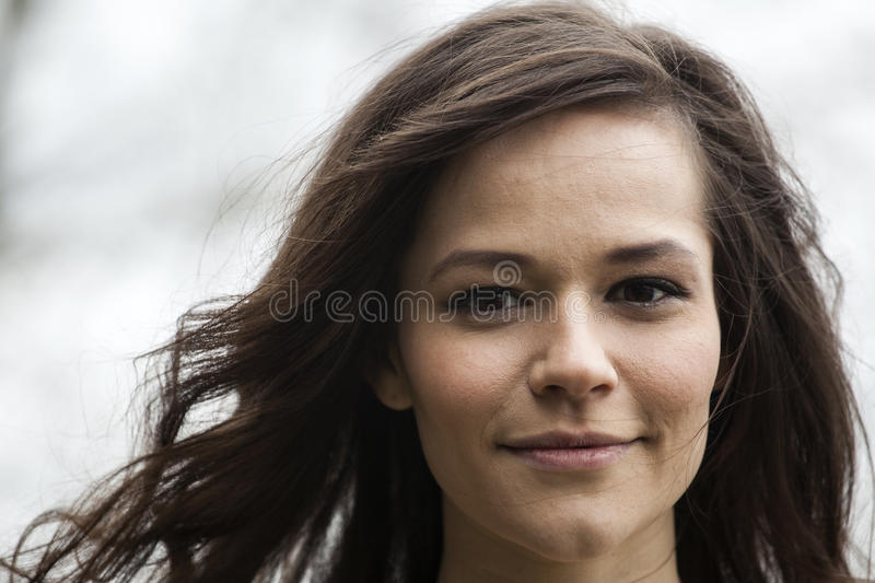 Portrait of Beautiful Young Woman with Brown Hair stock photo