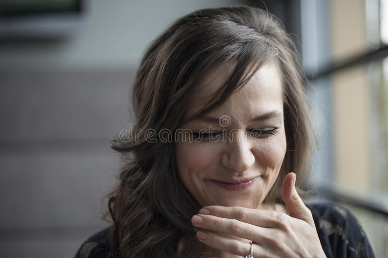 Portrait of Beautiful Young Woman with Brown Hair Laughing. Portrait of a beautiful young woman with brown hair laughing stock photos