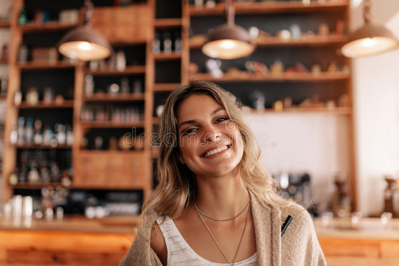 Portrait of beautiful young woman in a cafe stock photo