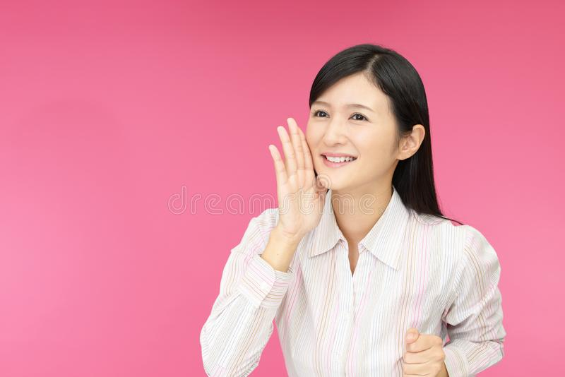 Young woman calling for someone stock images