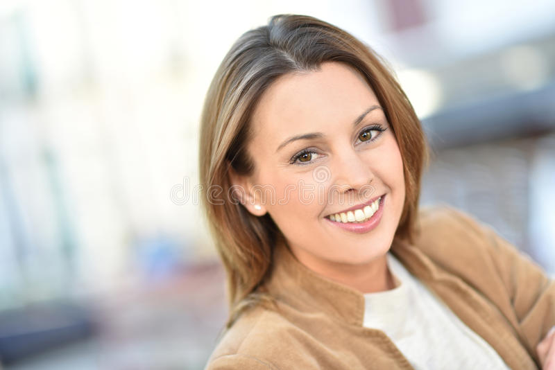 Portrait of beautiful young woman in city streets stock photos