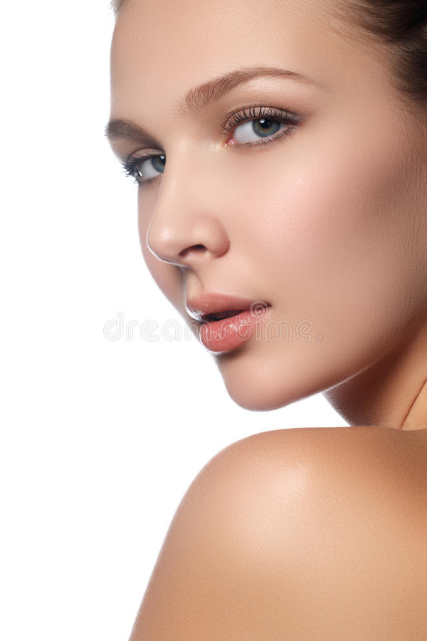 Portrait of beautiful young woman with clean face. High key royalty free stock photography