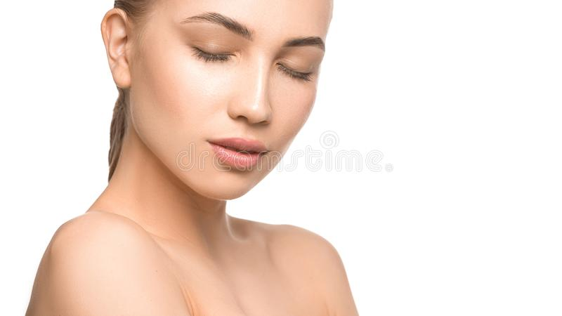 Portrait of beautiful young woman with closed eyes. Pure, natural skin. Isolated on white. Skin care, feminity and woman royalty free stock photo