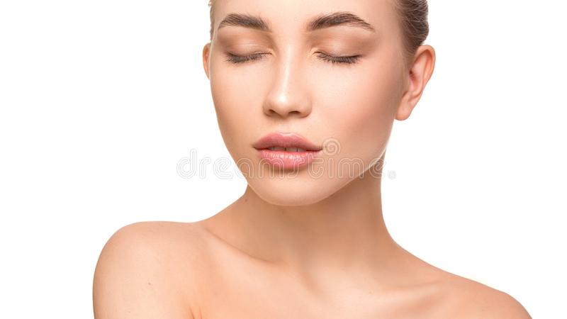 Portrait of beautiful young woman with closed eyes. Pure, natural skin. Isolated on white. Skin care and woman health stock photos