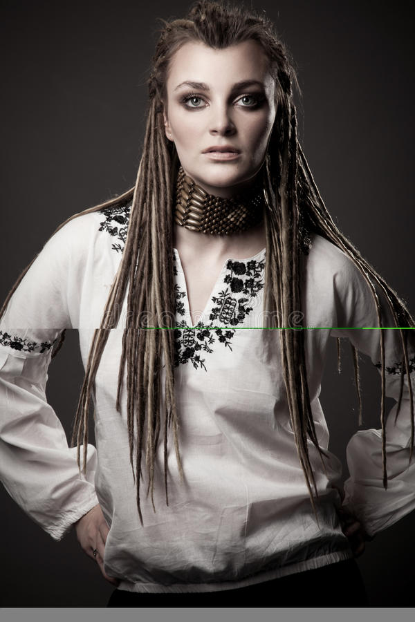 Portrait of a beautiful young woman with dreadlock stock photo