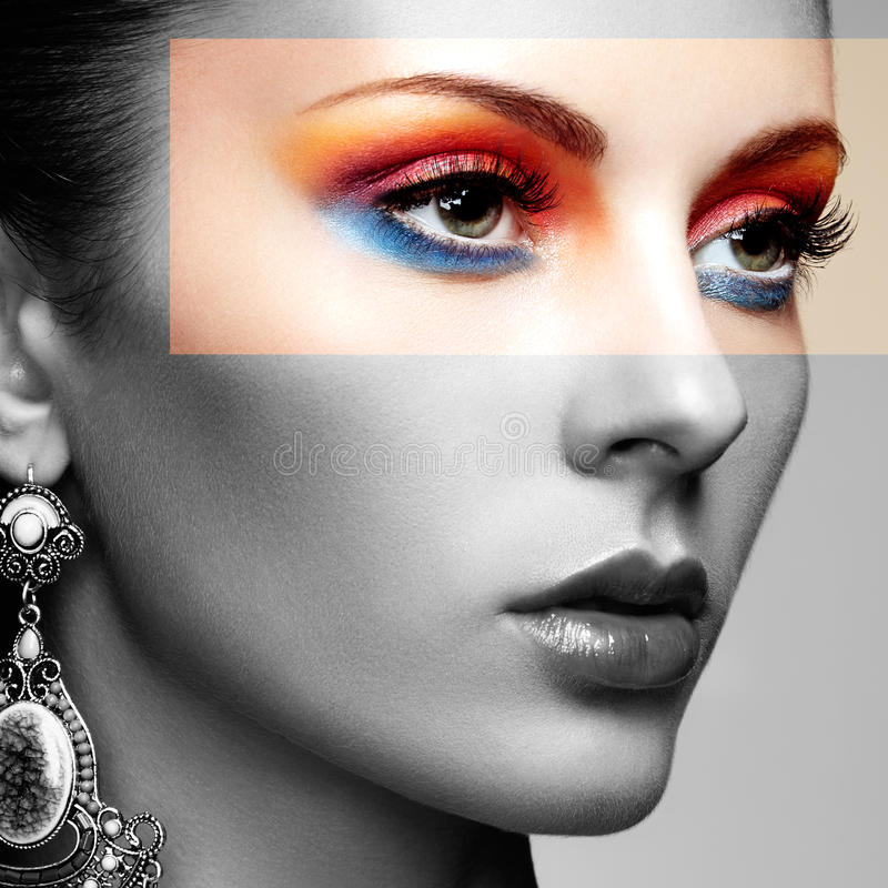 Portrait of beautiful young woman with earring. Jewelry and accessories. Perfect makeup. Fashion photo royalty free stock images