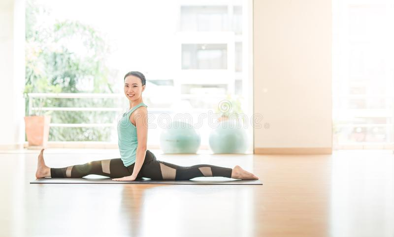 Asian woman Doing Yoga In yoga studio royalty free stock images