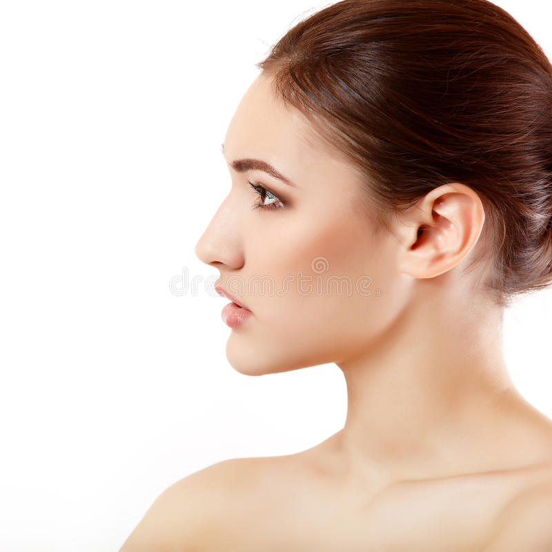 Portrait Of Beautiful Young Woman Face In Profile Stock