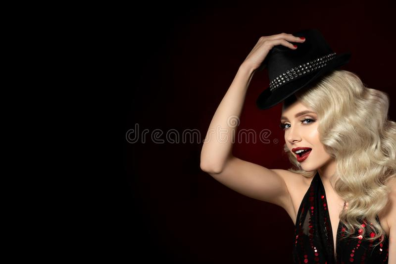 Portrait of beautiful young woman with fashion hat. Close up portrait of beautiful young woman holding black hat. Beautiful evening makeup - golden smokey eyes royalty free stock photos