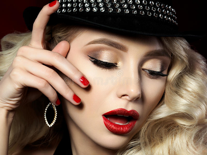 Portrait of beautiful young woman with fashion makeup royalty free stock photography
