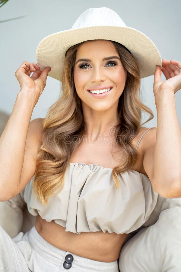 Portrait of smiling woman in fashionable hat royalty free stock image