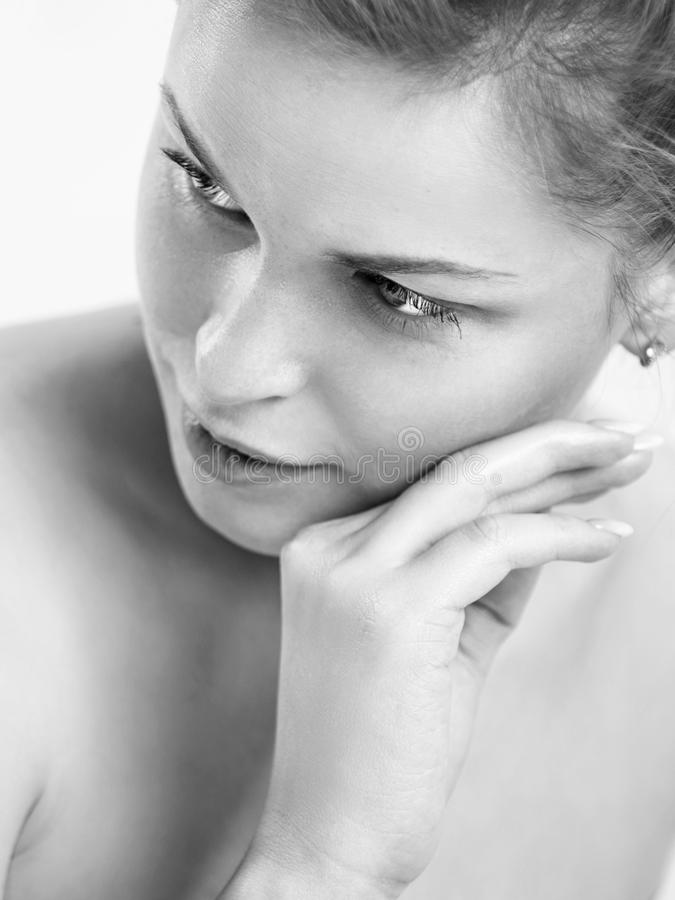 Portrait of a beautiful young woman. Female face closeup. Black and white photo royalty free stock image