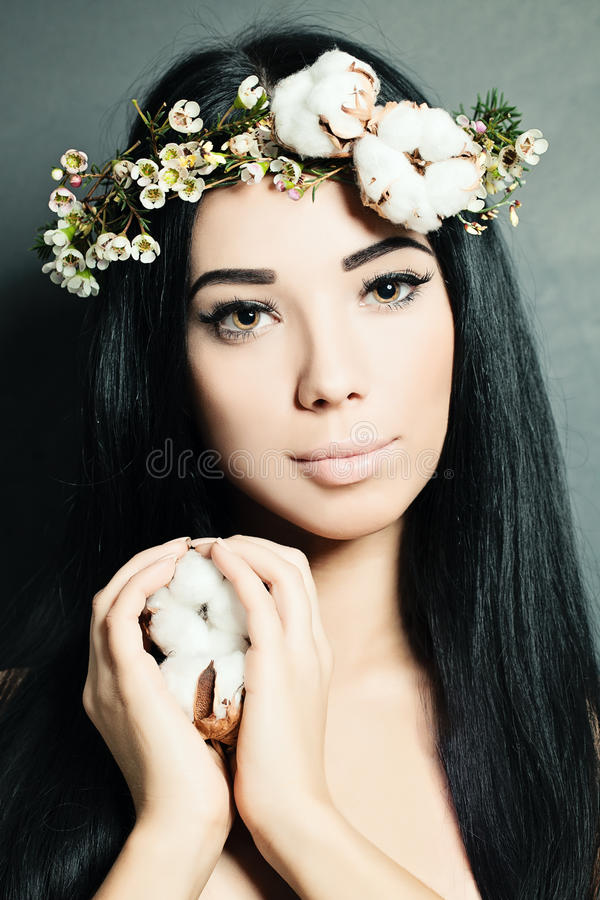 Portrait of Beautiful Young Woman with Flowers stock photo