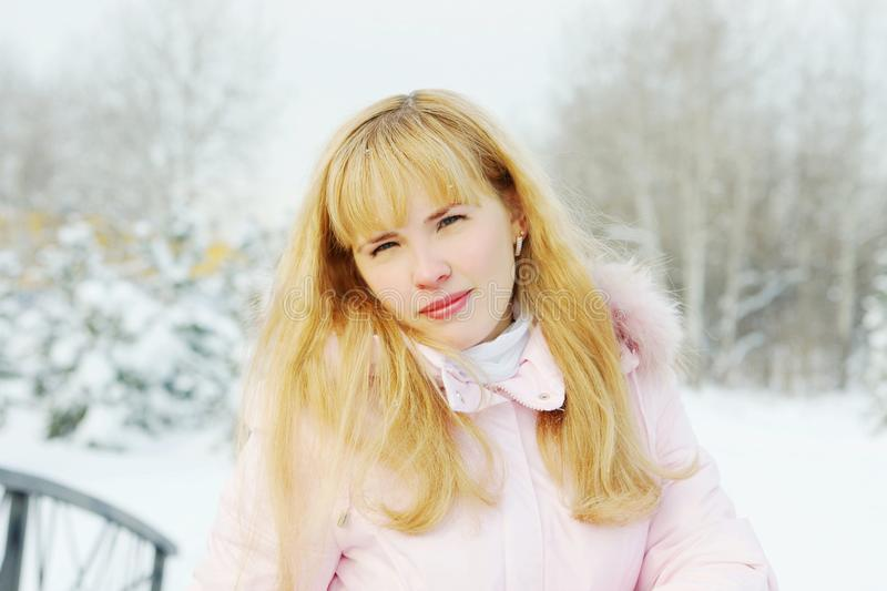 Portrait of a beautiful young woman with golden hair outdoor in winter royalty free stock photos
