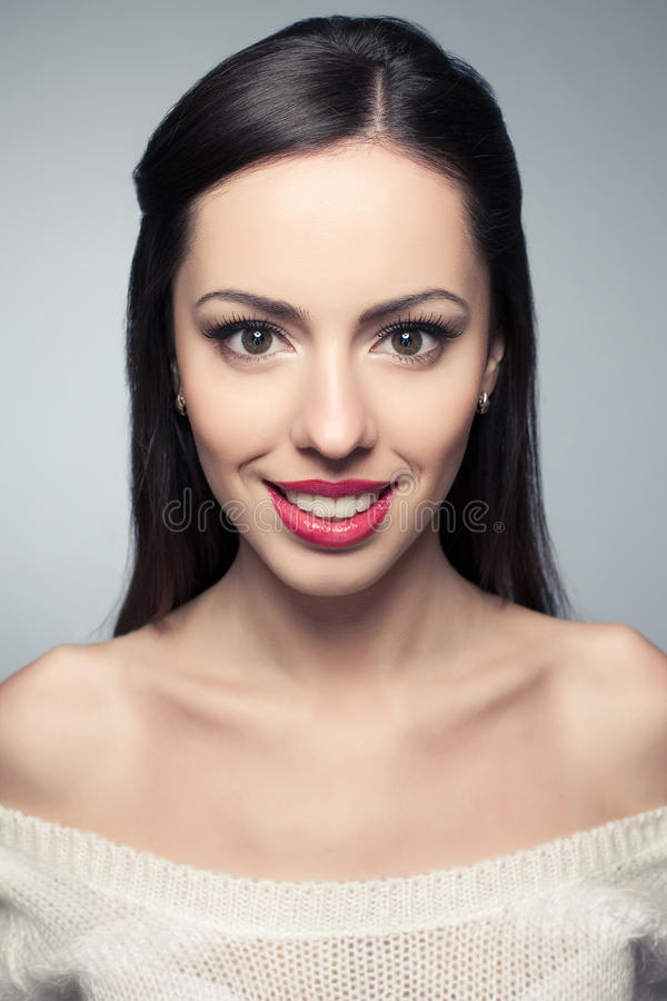 Portrait of beautiful young woman with great white shiny smile stock photo
