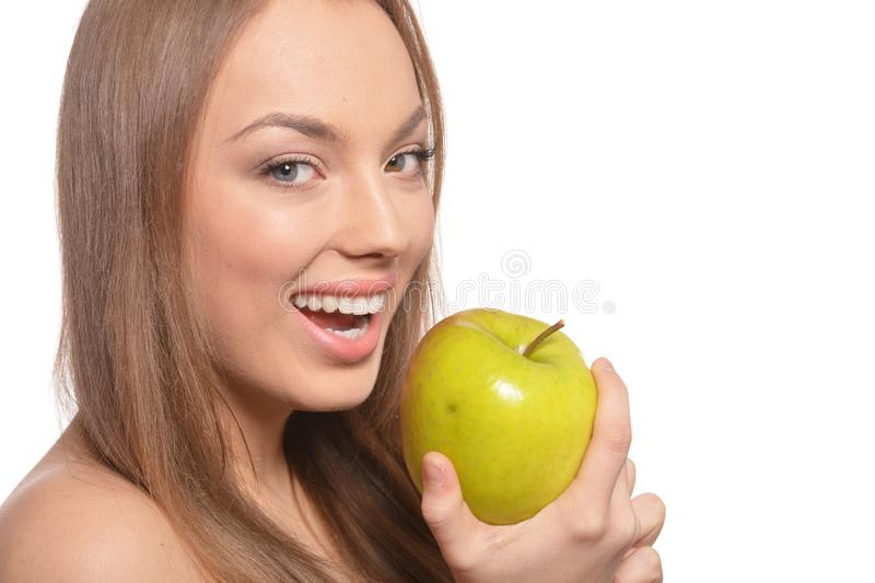 Portrait of beautiful young woman with green apple. Isolated on white background royalty free stock photography