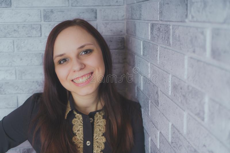 Portrait of beautiful young woman happiness standing on gray cement texture grunge wall brick background stock photography