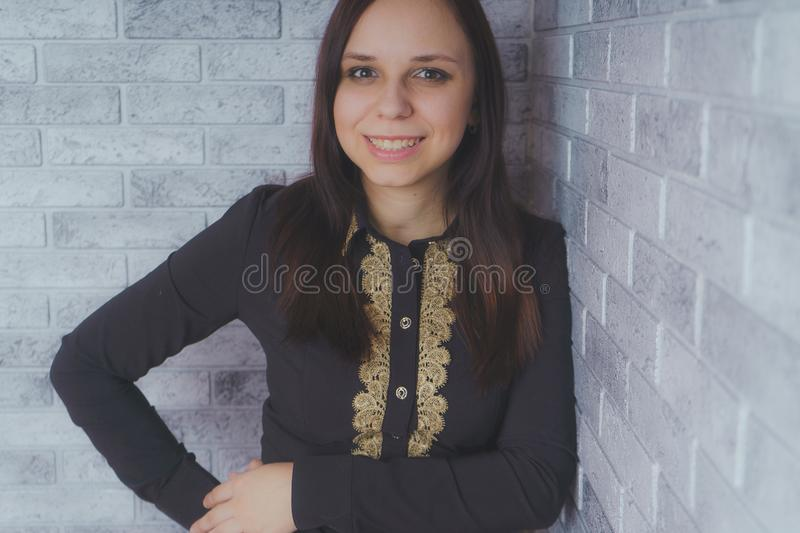 Portrait of beautiful young woman happiness standing on gray cement texture grunge wall brick background royalty free stock photo