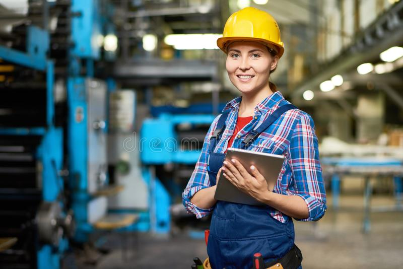 Happy Young Woman at Factory royalty free stock photos