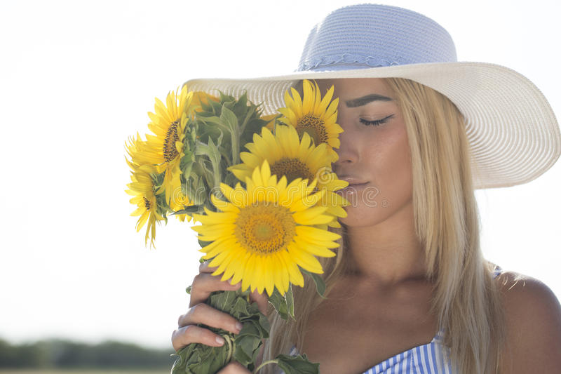Portrait of a beautiful young woman with a hat on a beautiful summer day stock image