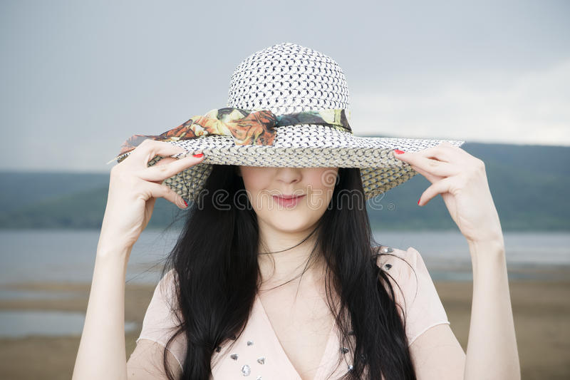 Portrait of a beautiful young woman in hat in summer stock photography