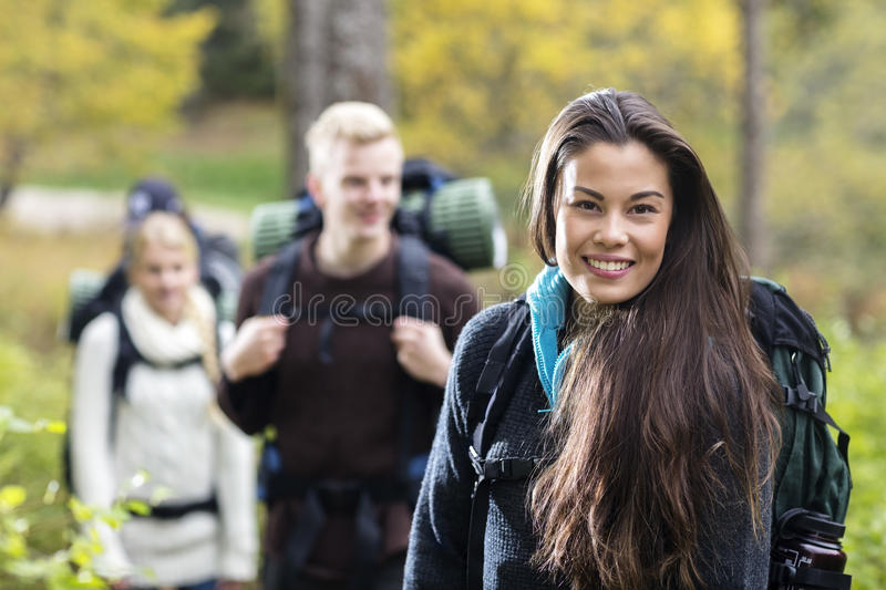 Portrait Of Beautiful Young Woman Hiking In Forest stock photos