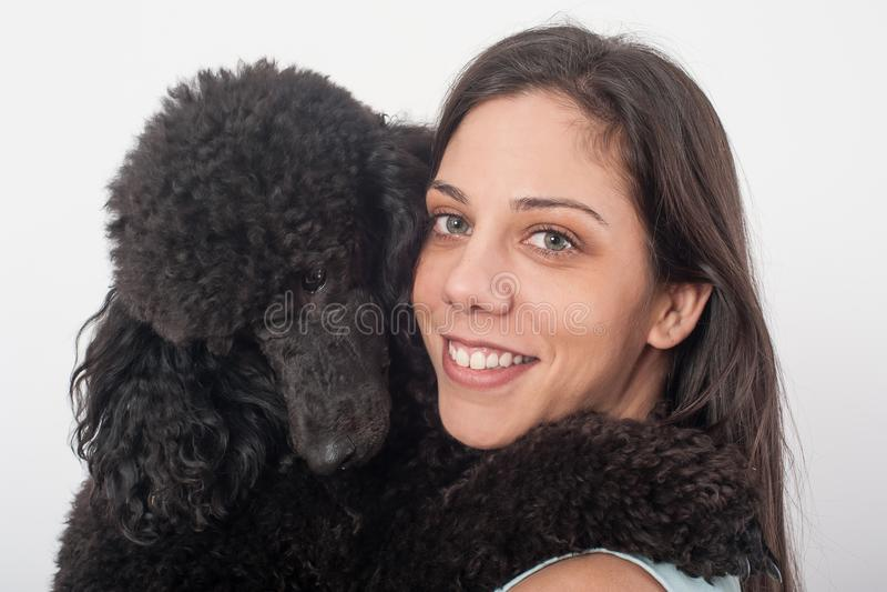 Portrait of a beautiful young woman hugging her beautiful dog stock photos