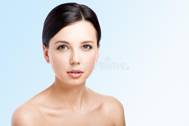 Portrait of beautiful young woman isolated on blue background royalty free stock photo