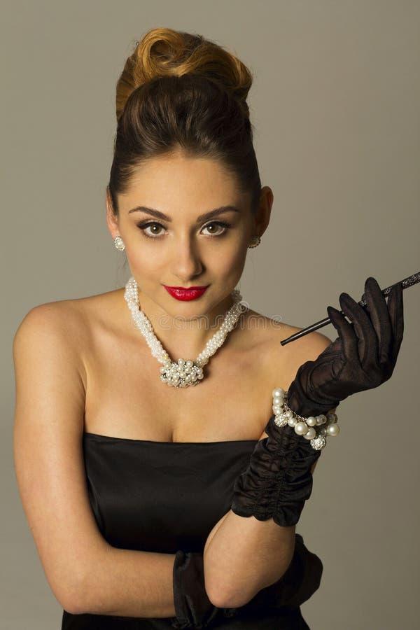 Portrait of beautiful woman like a famous actress. Portrait of beautiful young woman like a famous actress stock photography