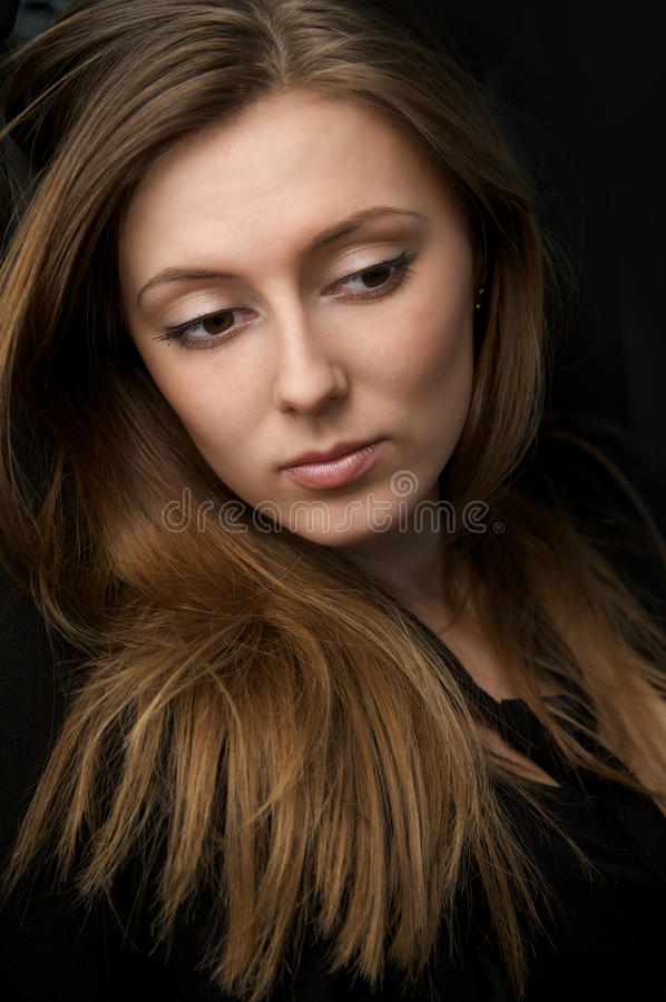 Portrait of beautiful young woman with long hair royalty free stock images