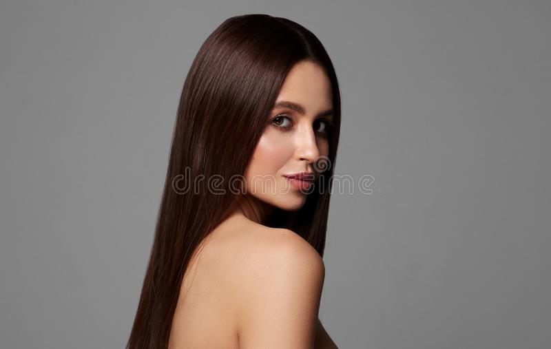 Portrait of beautiful young woman with long straight stock photography