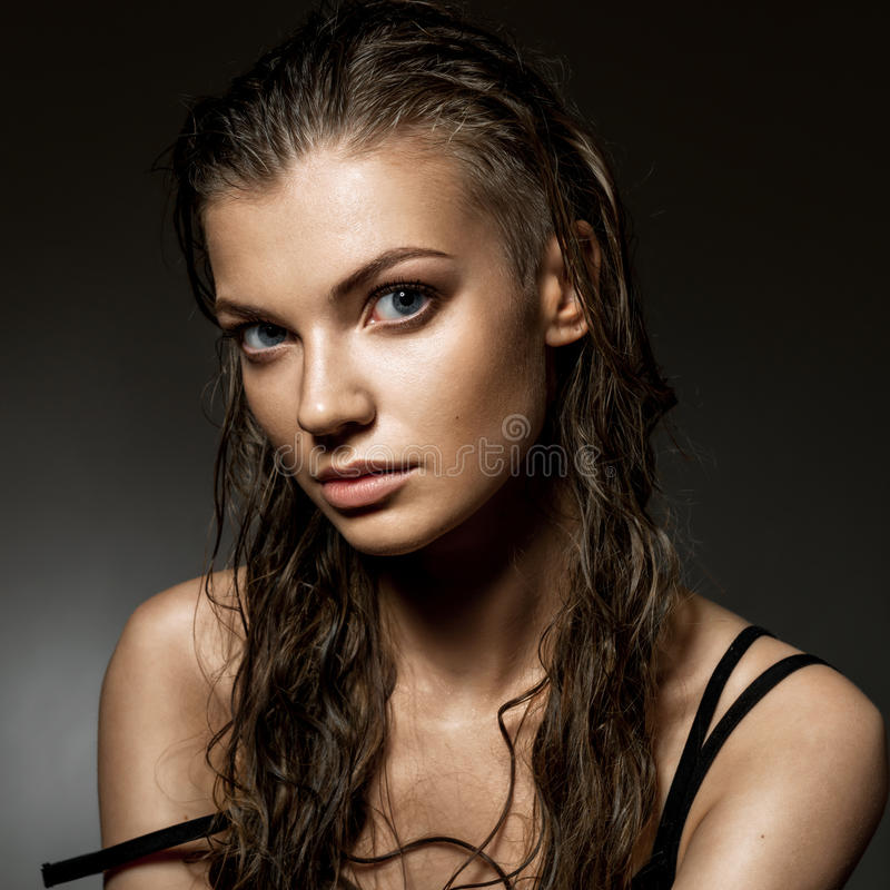 Portrait of beautiful young woman with long wet hairs. Low key s stock photos