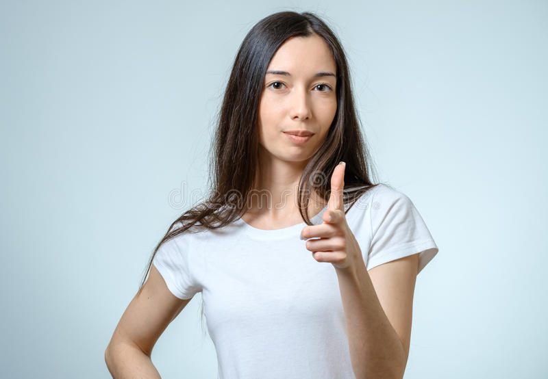 Portrait of a beautiful young woman looking at the camera and sm royalty free stock photography