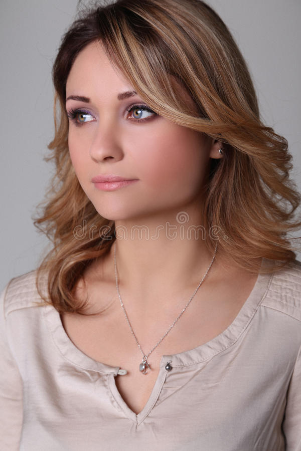 Portrait of a beautiful young woman looks into the distance royalty free stock photography