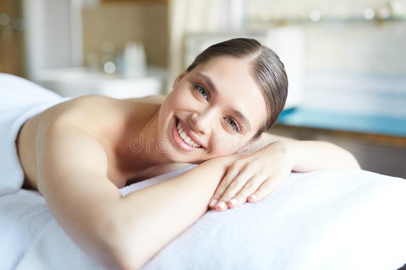Smiling Woman Relaxing in SPA stock photography