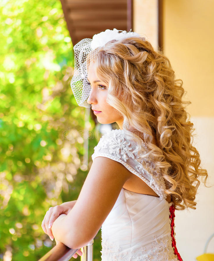 Portrait of beautiful young woman. Make up and hair style. Wedding bride make up. royalty free stock images