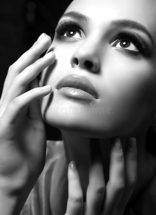 Portrait of beautiful young woman with makeup royalty free stock photo