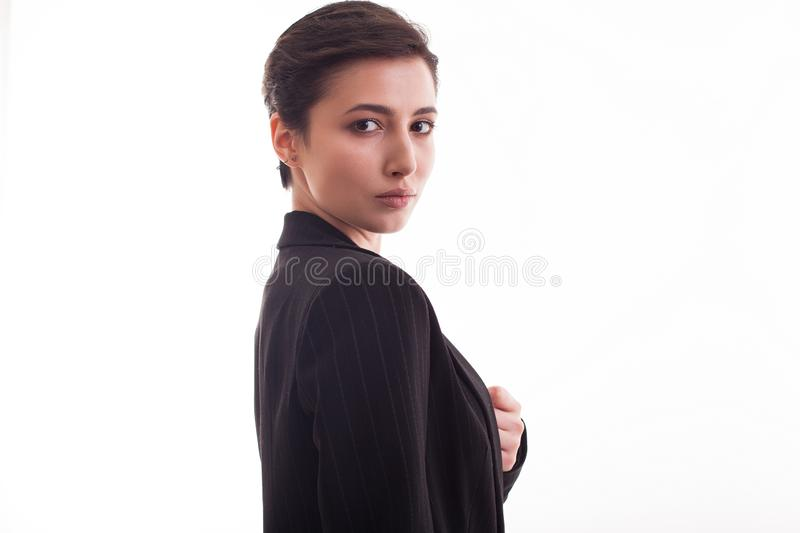 Portrait of beautiful young woman with natural makeup wearing a black jacket royalty free stock photo