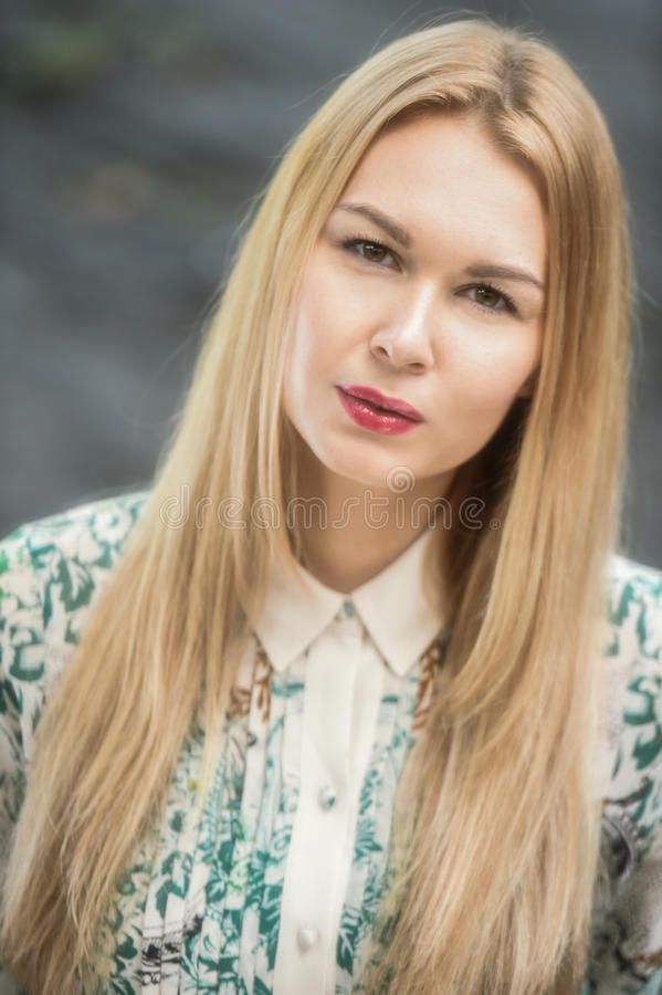 A portrait of a beautiful young woman outdoor. royalty free stock photo