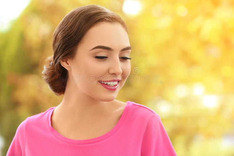 Portrait of beautiful young woman. Outdoors stock images