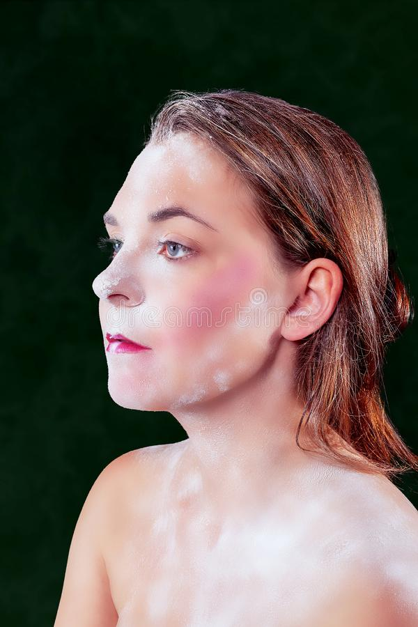 Portrait of a powdered woman royalty free stock photography