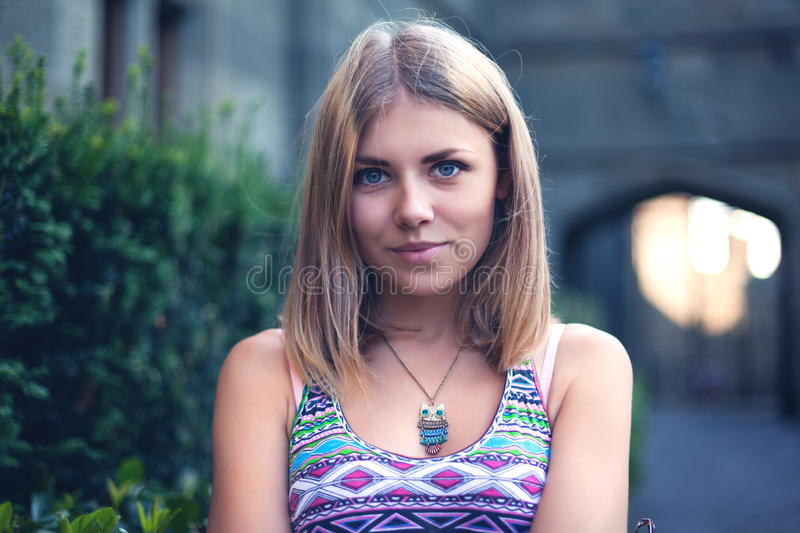 Portrait of a beautiful young woman in park stock photo