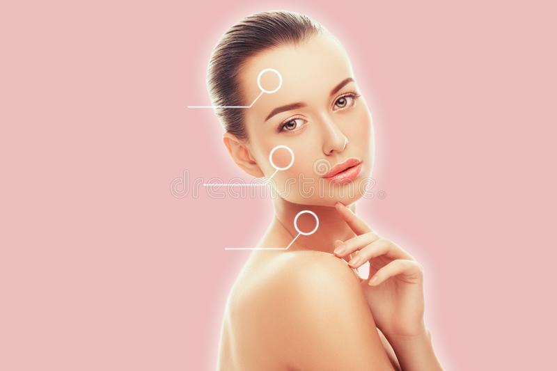 Portrait of beautiful young woman with perfect clean skin isolated on pink background. Beauty Wellness Treatment Fashion People royalty free stock photography
