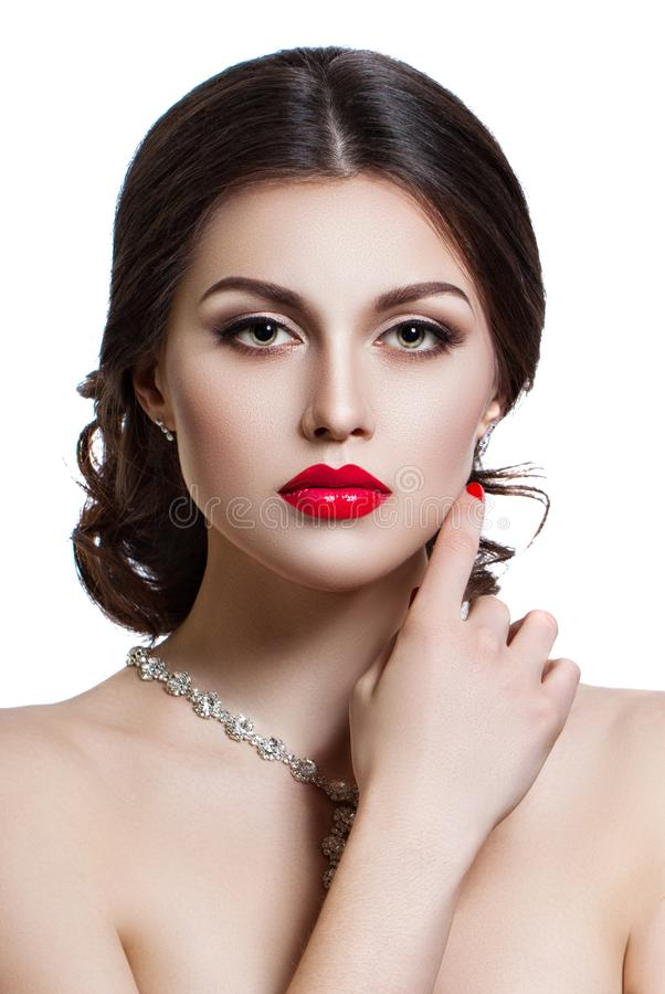 Portrait of a beautiful young woman with a professional make-up on a white background. The ideal beauty. Red lips. royalty free stock photography