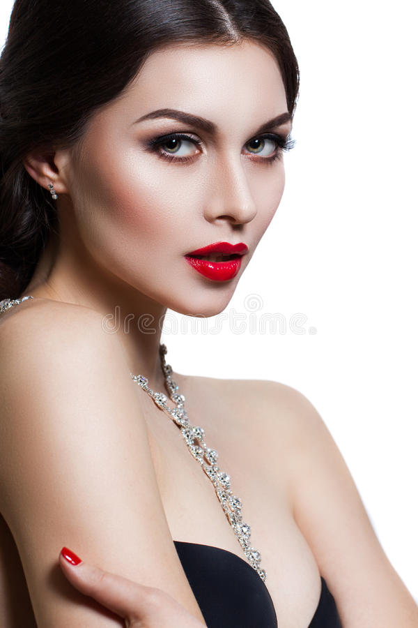 Portrait of a beautiful young woman with a professional make-up on a white background. Perfect beauty stock images