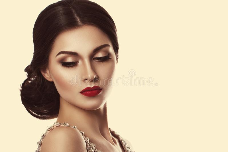 Portrait of a beautiful young woman in retro style. Ideal beauty. Red lips. royalty free stock image