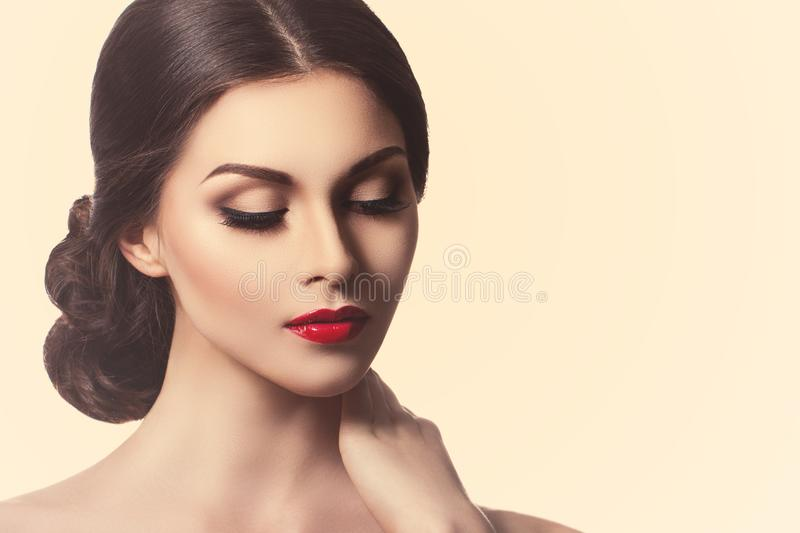 Portrait of a beautiful young woman in retro style. Ideal beauty. Red lips. Professional make-up. stock image